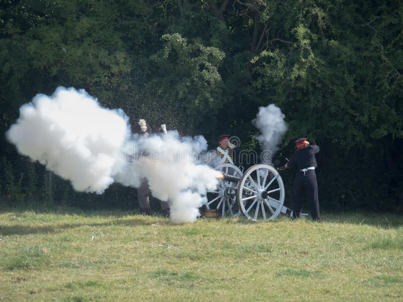 Waterloo, Belgium - June 18 2017: Scenes from the reenactment of. Waterloo, Belgium - June 18 2017: Soldiers reload and fire a cannon during the re-enactment of stock photography