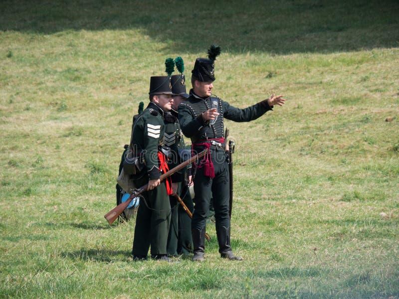 Waterloo, Belgium - June 18 2017: Scenes from the reenactment of. Waterloo, Belgium - June 18 2017: Several figurants dressed in 19the century military equipment stock images