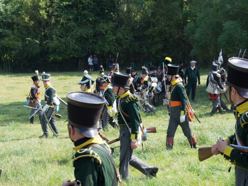 Waterloo, Belgium - June 18 2017: Scenes from the reenactment of. Waterloo, Belgium - June 18 2017: Several figurants dressed in 19the century military equipment stock photography