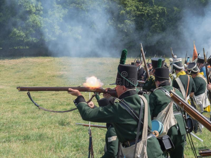 Waterloo, Belgium - June 18 2017: Scenes from the reenactment of. Waterloo, Belgium - June 18 2017: Soldiers of the allied forces fire their muskets during the royalty free stock photo