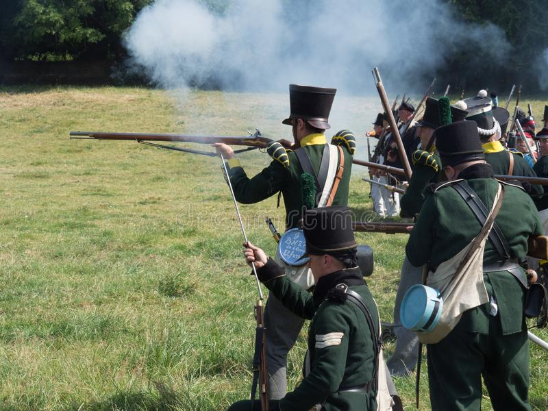 Waterloo, Belgium - June 18 2017: Scenes from the reenactment of. Waterloo, Belgium - June 18 2017: Soldiers of the allied forces fire their muskets during the stock photo