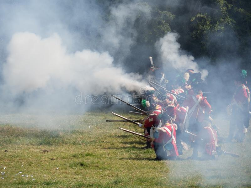 Waterloo, Belgium - June 18 2017: Scenes from the reenactment of. Waterloo, Belgium - June 18 2017: Soldiers of the allied forces fire their muskets during the stock images