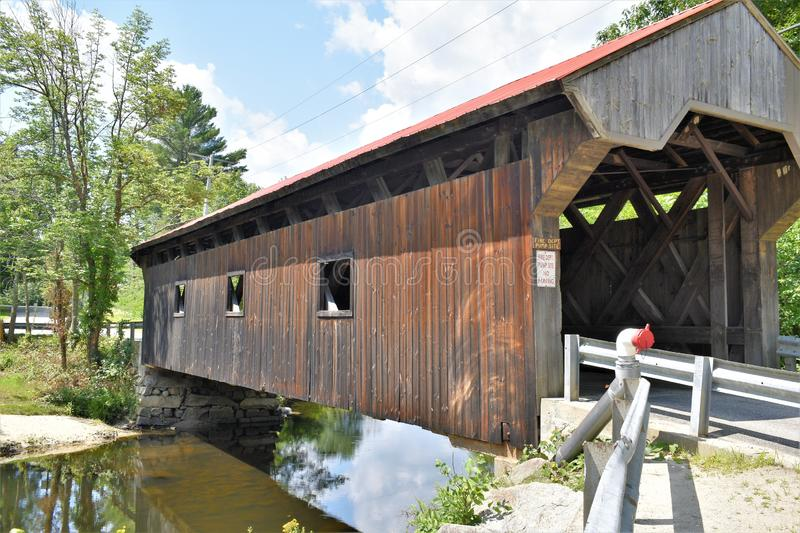 Waterloo Covered Bridge, Town of Warner, Merrimack county, New Hampshire, United States,  New England. Side view of the Waterloo Covered Bridge and surrounding royalty free stock images
