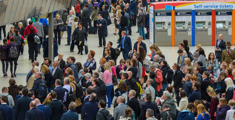 Waterloo Station Commuters. A picture of commuters at rush hour on Waterloo station checking the train timetables. Picture taken May 2015 stock photos