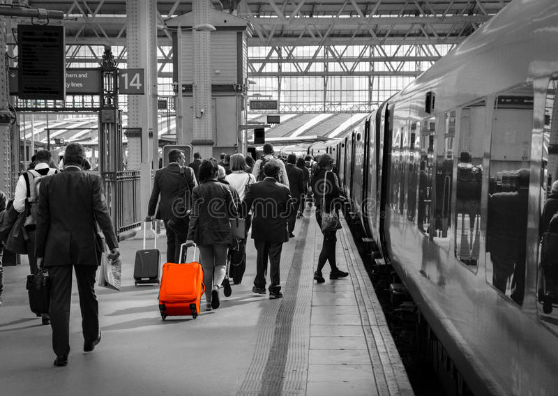 Waterloo Station Travellers Boarding Train. A picture of commuters at rush hour boarding a train. Picture taken on May 2015 royalty free stock image