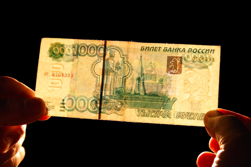 Watermark 1000 rubles. Checking watermark 1000 russian rubles isolated on black stock photos