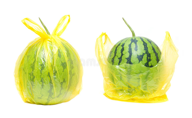 Watermelon in the plastic bag isolated on white background stock image
