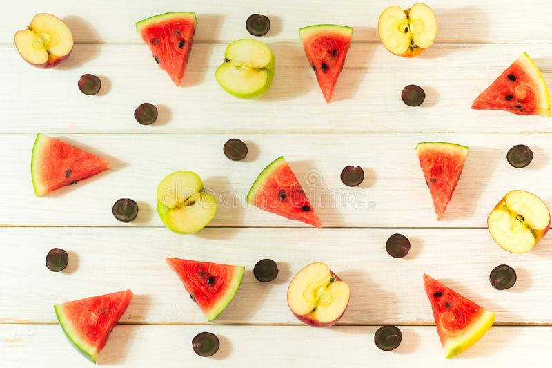 Watermelon and apples cut into small pieces royalty free stock photos
