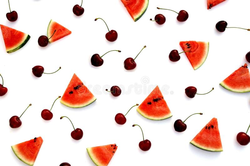 Watermelon and cherries fresh fruit top view. On white background; fruit flat lay disposition stock photos