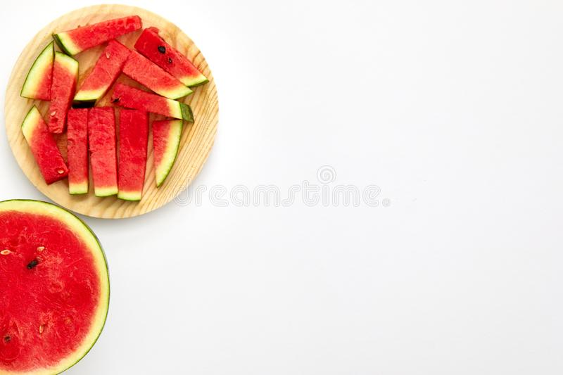 Watermelon cut in half and slices isolated in white background with copy space viewed from above stock photos