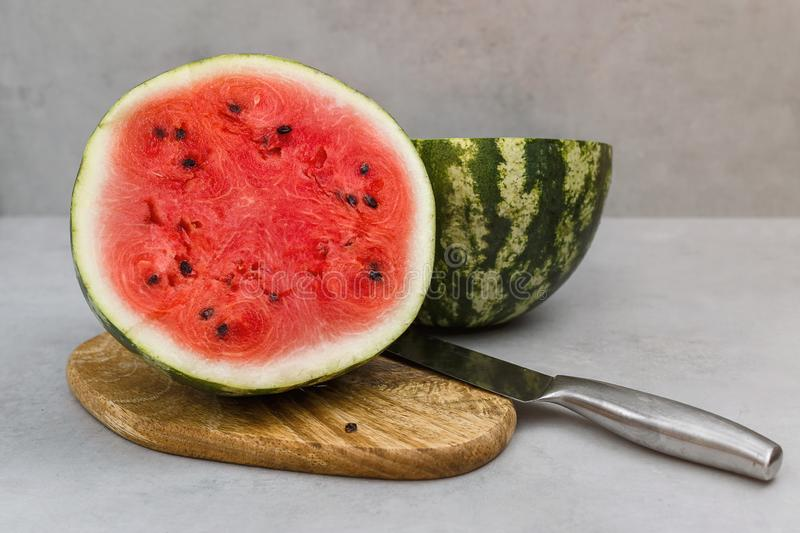 Fresh watermelon cut with knife. Watermelon cut half in two pieces stock photography