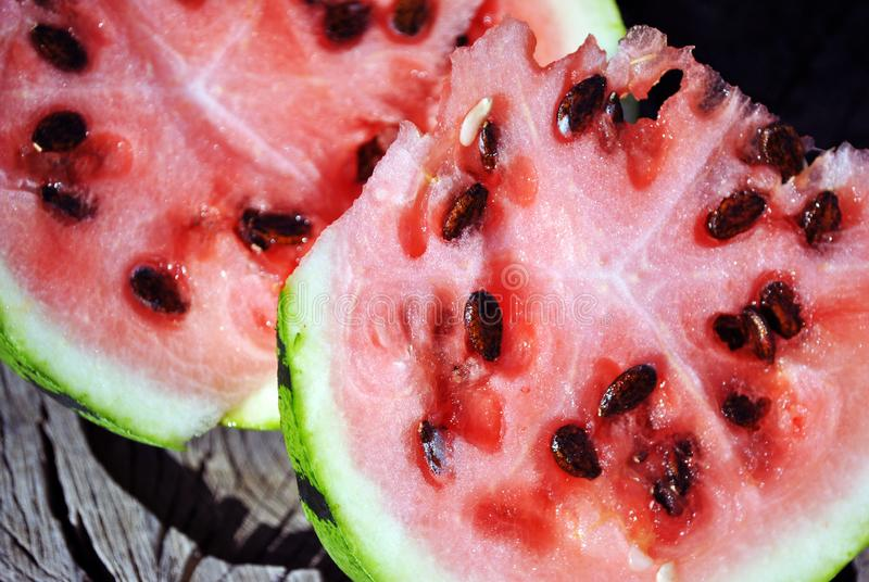 Watermelon cut slices macro detail close up, organic background texture. Top view stock photo