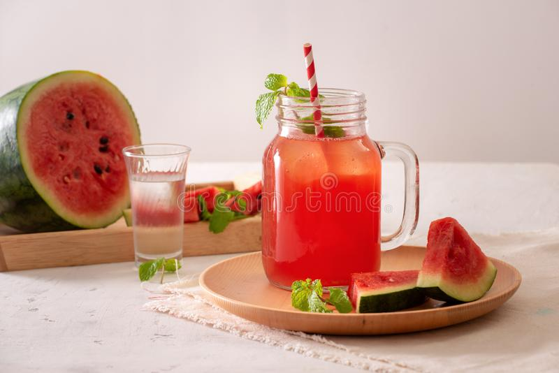 Watermelon drink in glass with slices of watermelon on whitebackground.  royalty free stock photo