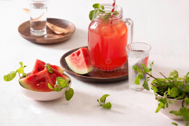 Watermelon drink in glass with slices of watermelon on whitebackground.  royalty free stock photos