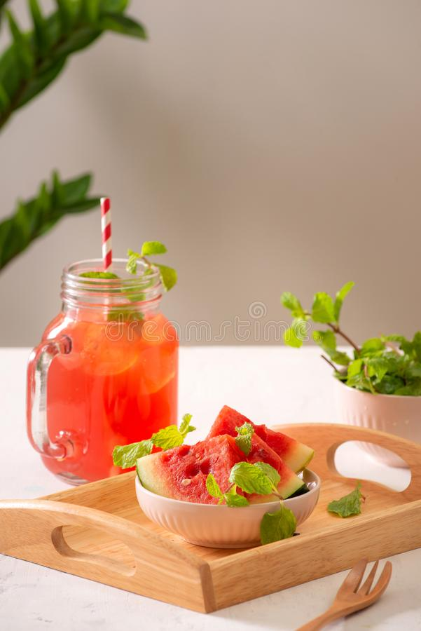 Watermelon drink in glass with slices of watermelon on white background.  stock image