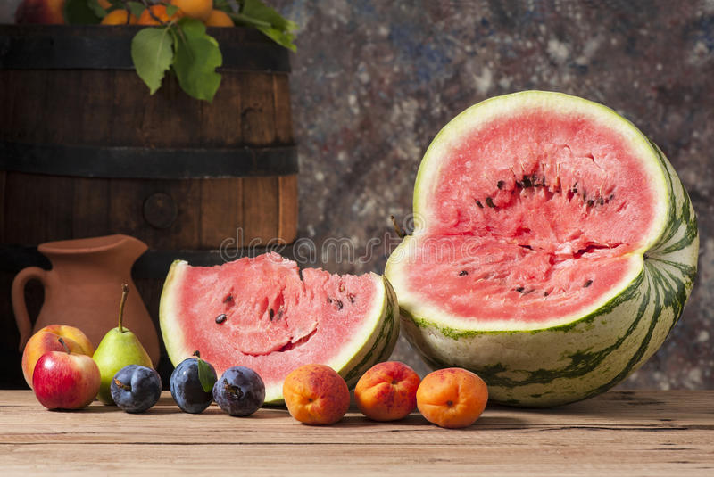 Watermelon, fresh fruit and wooden barrel royalty free stock photos