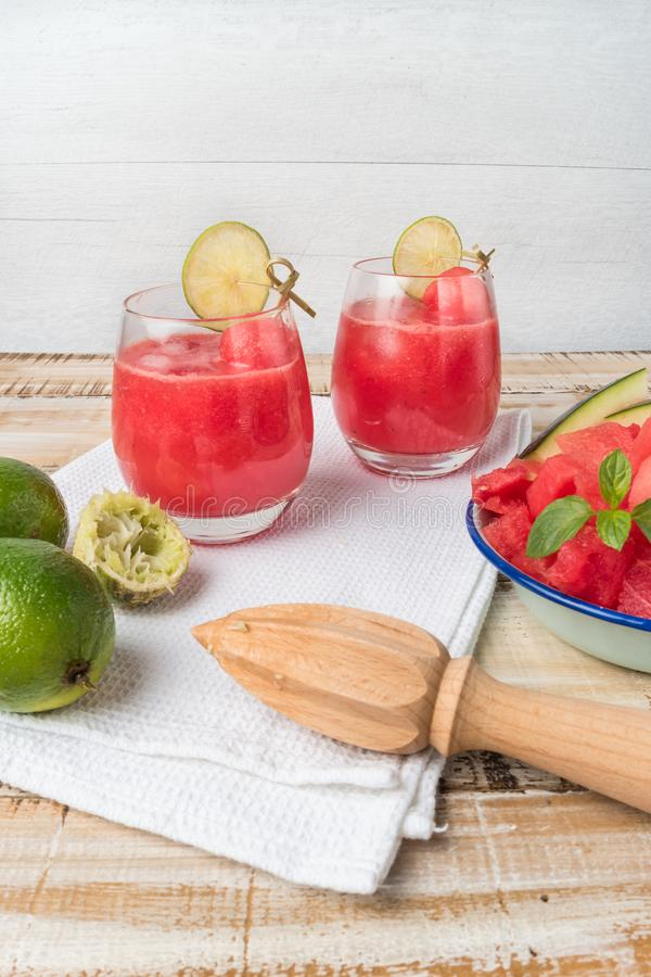 Watermelon fresh juice with mint leaves and lime citrus stock photos