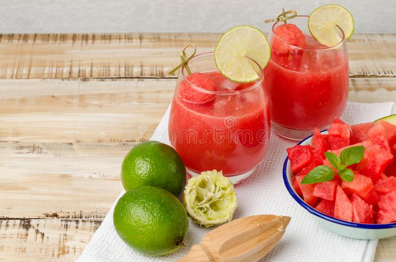 Watermelon fresh juice with mint leaves and lime citrus stock image