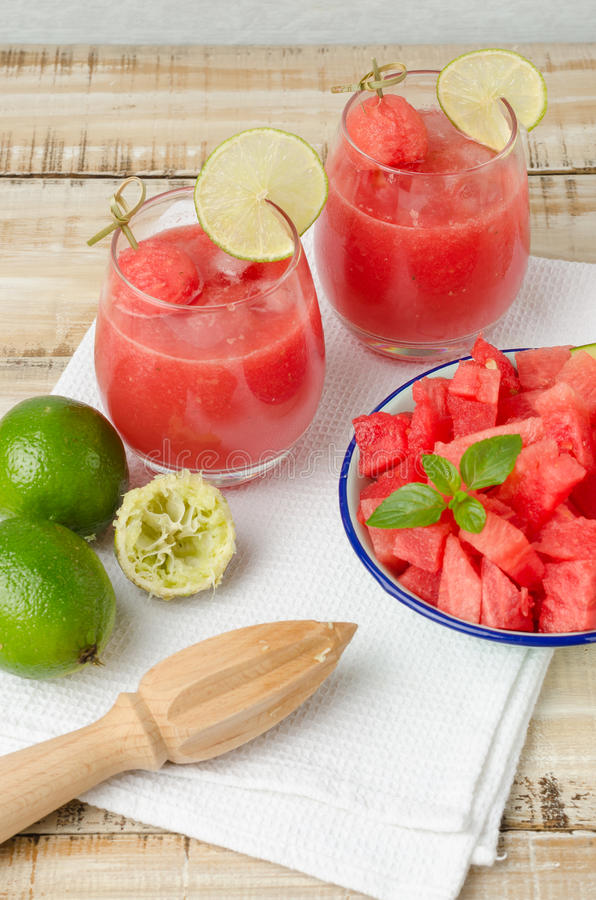 Watermelon fresh juice with mint leaves and lime citrus royalty free stock photography