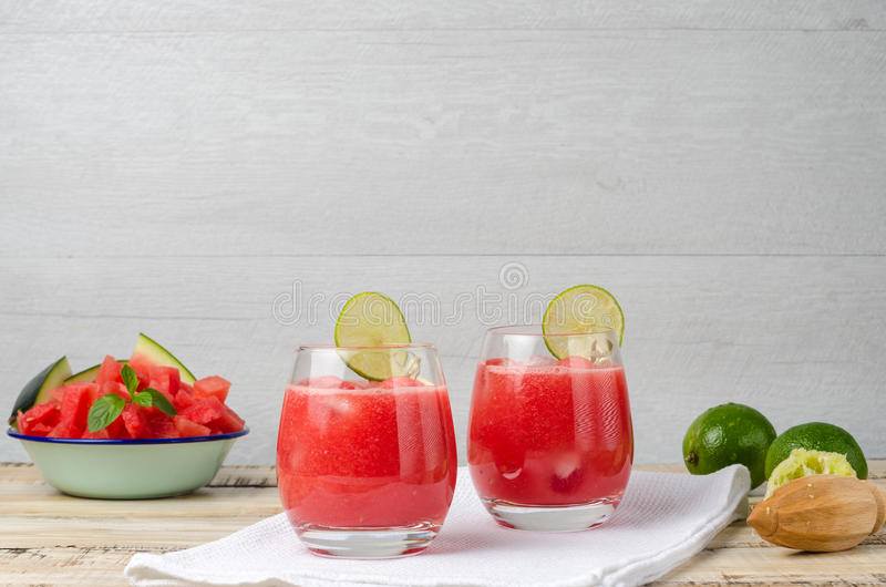 Watermelon fresh juice with mint leaves and lime citrus royalty free stock image