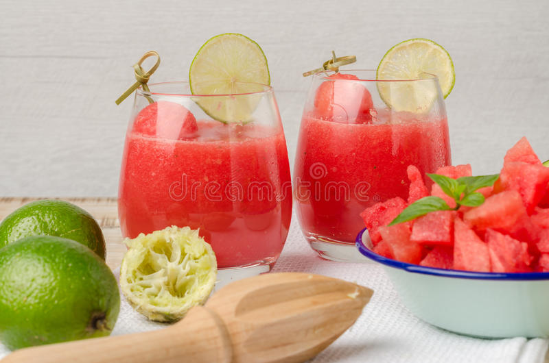 Watermelon fresh juice with mint leaves and lime citrus stock images