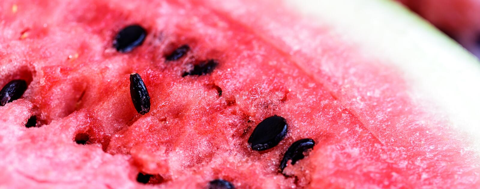 Watermelon fresh sliced of red with magnified macro shot and close up shot on wood table. Background royalty free stock images