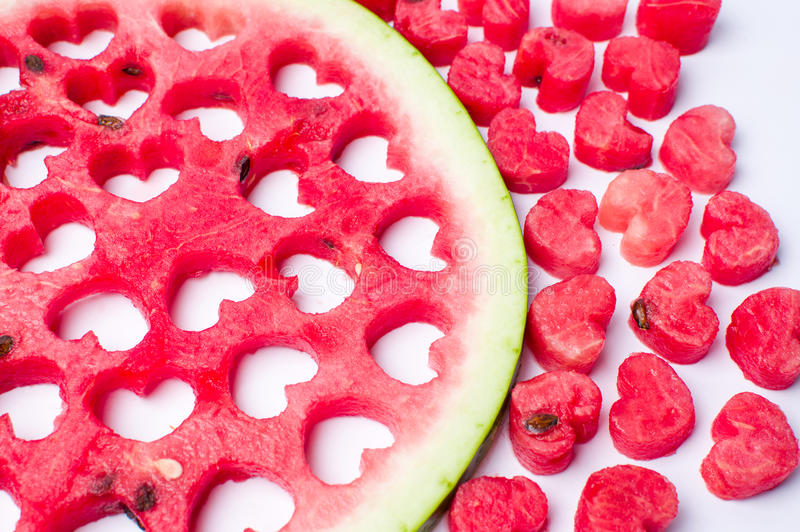 Watermelon fruit with heart shaped cut outs stock photo