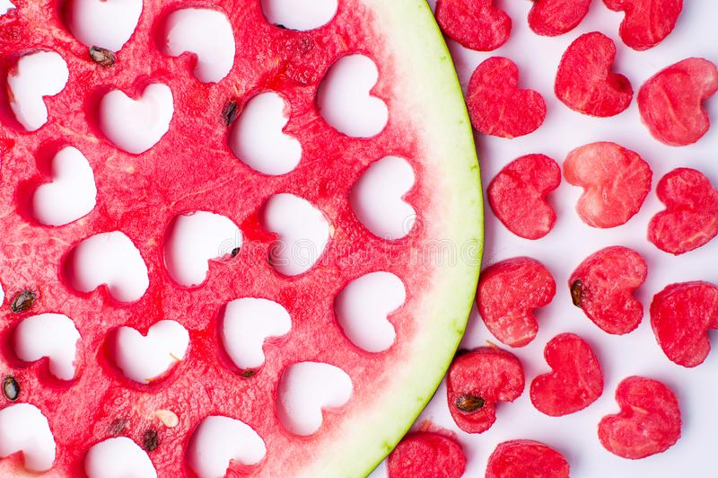Watermelon fruit with heart shaped cut outs. Isolated stock images