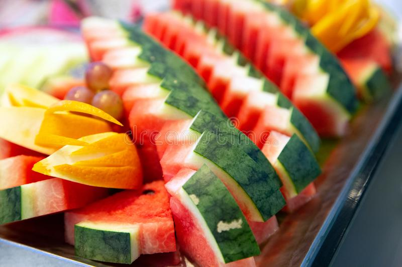 Watermelon has been beautifully trimmed on fruit platters stock photos