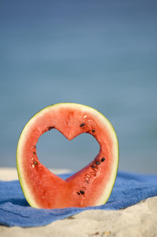 Watermelon heart. On a beach royalty free stock image