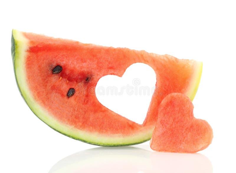 Watermelon heart. Watermelon slice with heart shape hole stock image