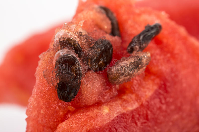 Watermelon with Huge magnified macro shot and close up shot on w. Ood table stock photo