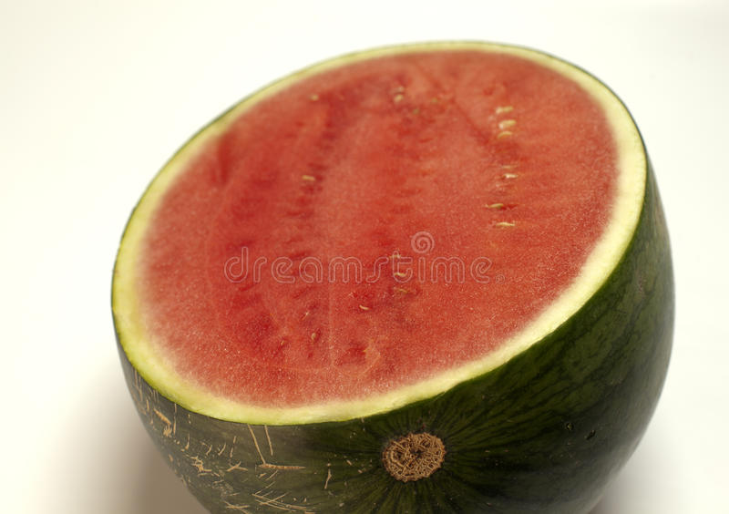 Watermelon on the kitchen table stock image