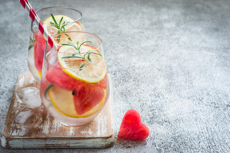 Watermelon lemon cocktail with pieces of watermelon in shape of heart. Valentine`s Day Concept.  stock photos