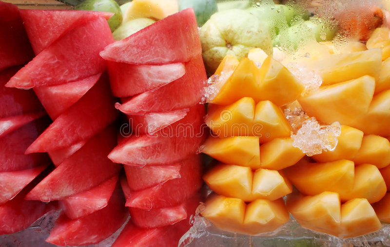 Watermelon and mango on ice royalty free stock photos