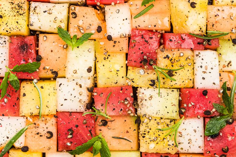 Watermelon and Melon Cubes with HErbs and Spices, Top View, Creative Party Food Serving stock image