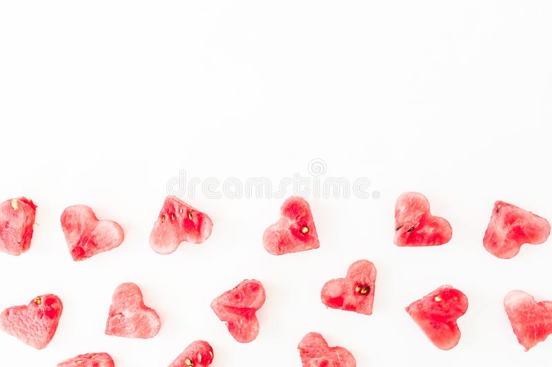 Watermelon pattern on white background. Heart pattern concept. Flat lay, top view stock images