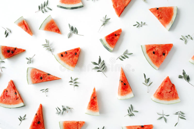 Watermelon pieces pattern on white background. Flat lay, top view stock images
