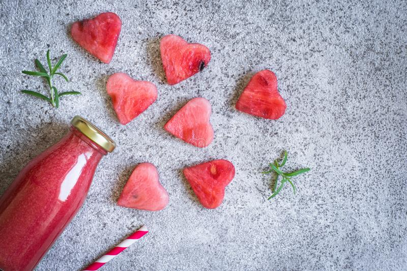 Watermelon rosemary smoothies in a bottle And pieces of watermelon in the form of heart. Watermelon rosemary smoothies in a bottle And pieces of watermelon in stock photo