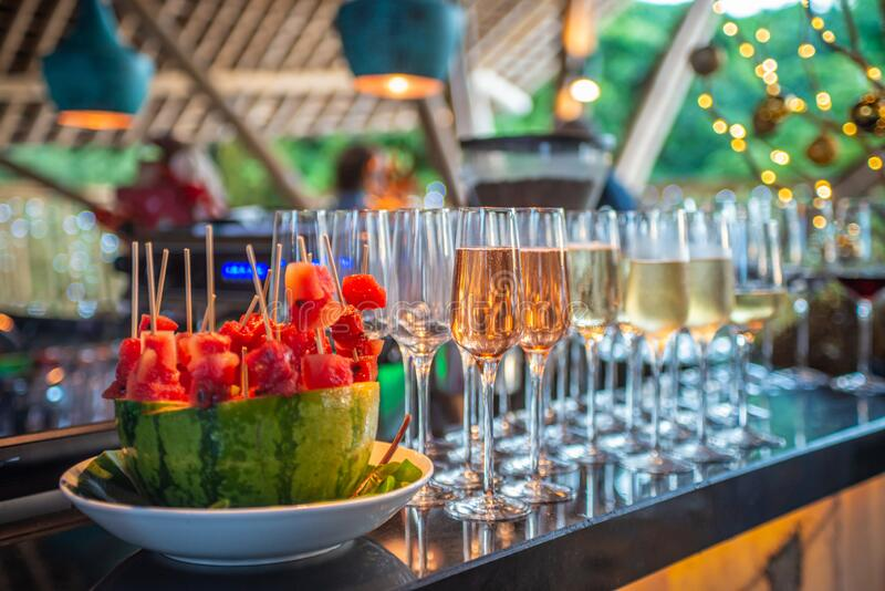 Watermelon short eats with champagne selection in glasses at the bar stock photo