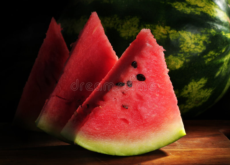 Watermelon slice. Detail in ark ith green skin royalty free stock images