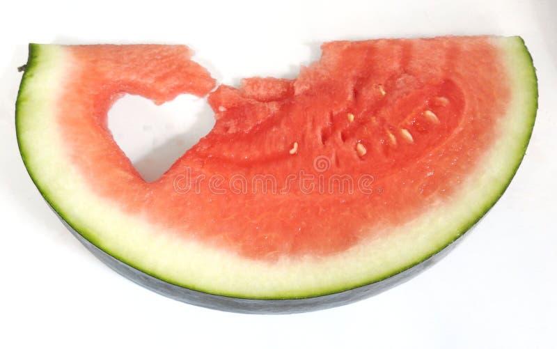Watermelon heart. Watermelon slice. Watermelon slice with heart shape hole. Watermelon slice with heart shape hole royalty free stock images