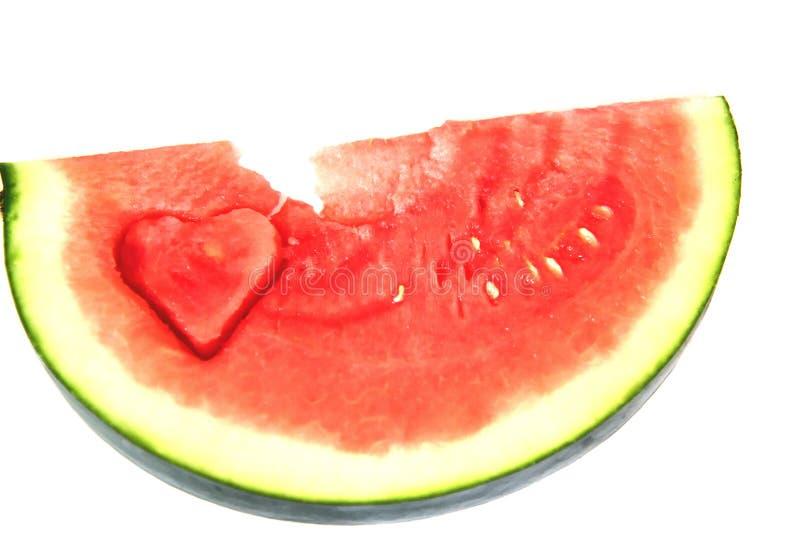 Watermelon heart. Watermelon slice. Watermelon slice with heart shape hole. Watermelon slice with heart shape hole stock image