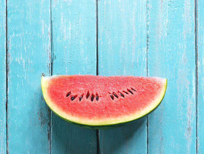Image result for watermelon on blue wooden table