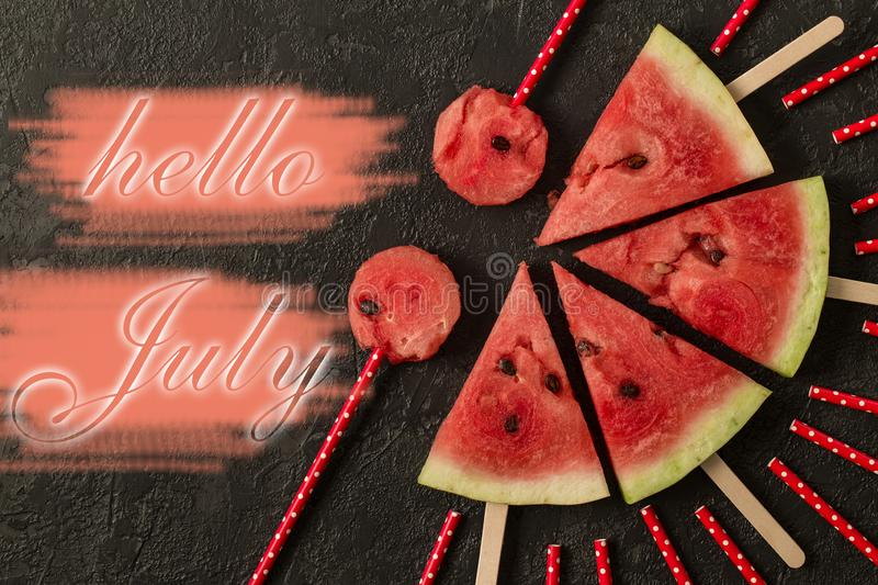 Watermelon slice with text Hello July, on dark background royalty free stock images
