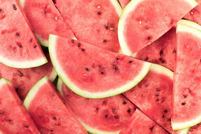 Watermelon slices background. Top view of fresh watermelon slices background stock image