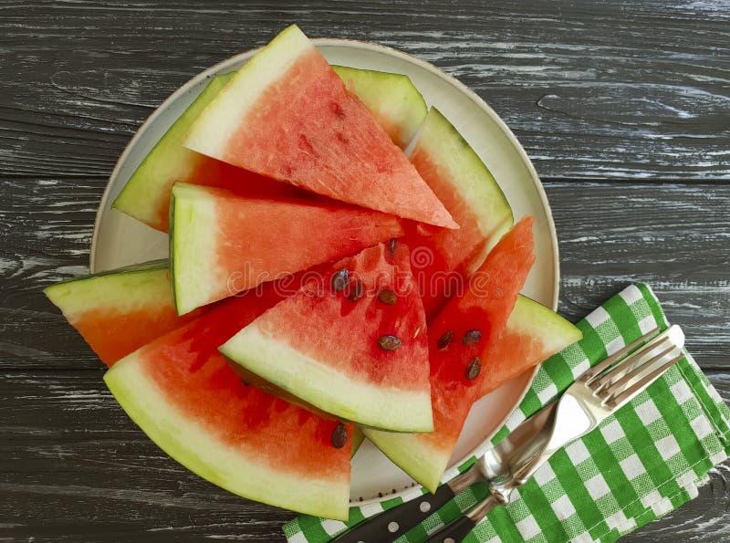 Watermelon slices detox on a black wooden background. Watermelon slices on a black wooden background nutrition detox royalty free stock photo