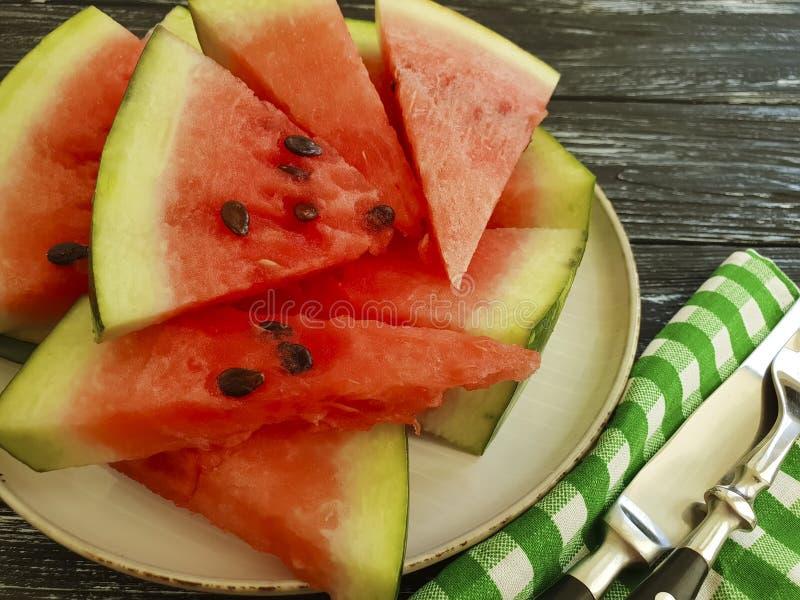 Watermelon slices detox on a black wooden background. Watermelon slices on a black wooden background nutrition detox summer stock image