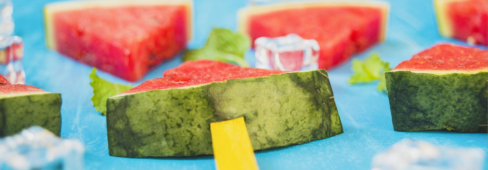 Watermelon slices and mint on bright and ice blue wood background,concept organic fruit  non-toxic for health,for refreshing and. Fun in summer,baner panoramic stock photo