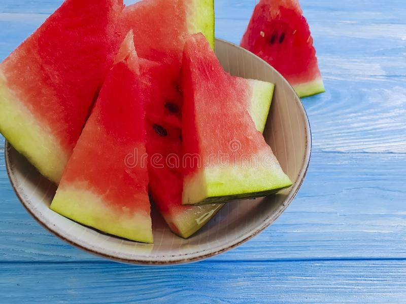 Watermelon slices natural, plate organic sweet summertime on a blue wooden background. Watermelon slices plate on a blue wooden background summertime natural royalty free stock photos